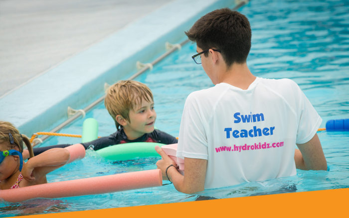 Swim teacher with floats teacher children with noodles